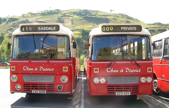 two red buses side by side reading Oban and District