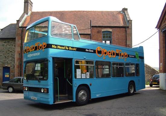 bright blue open top bus