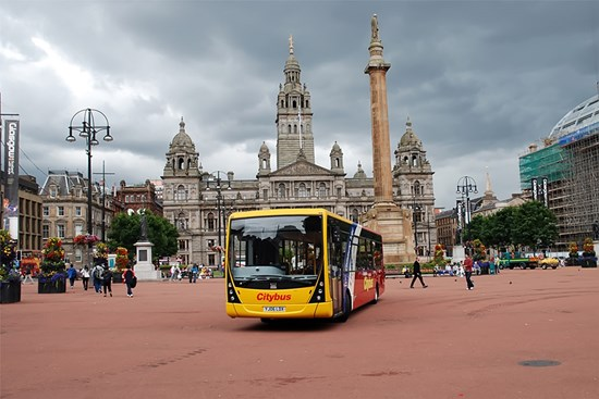 yellow and red bus parked up on George Square