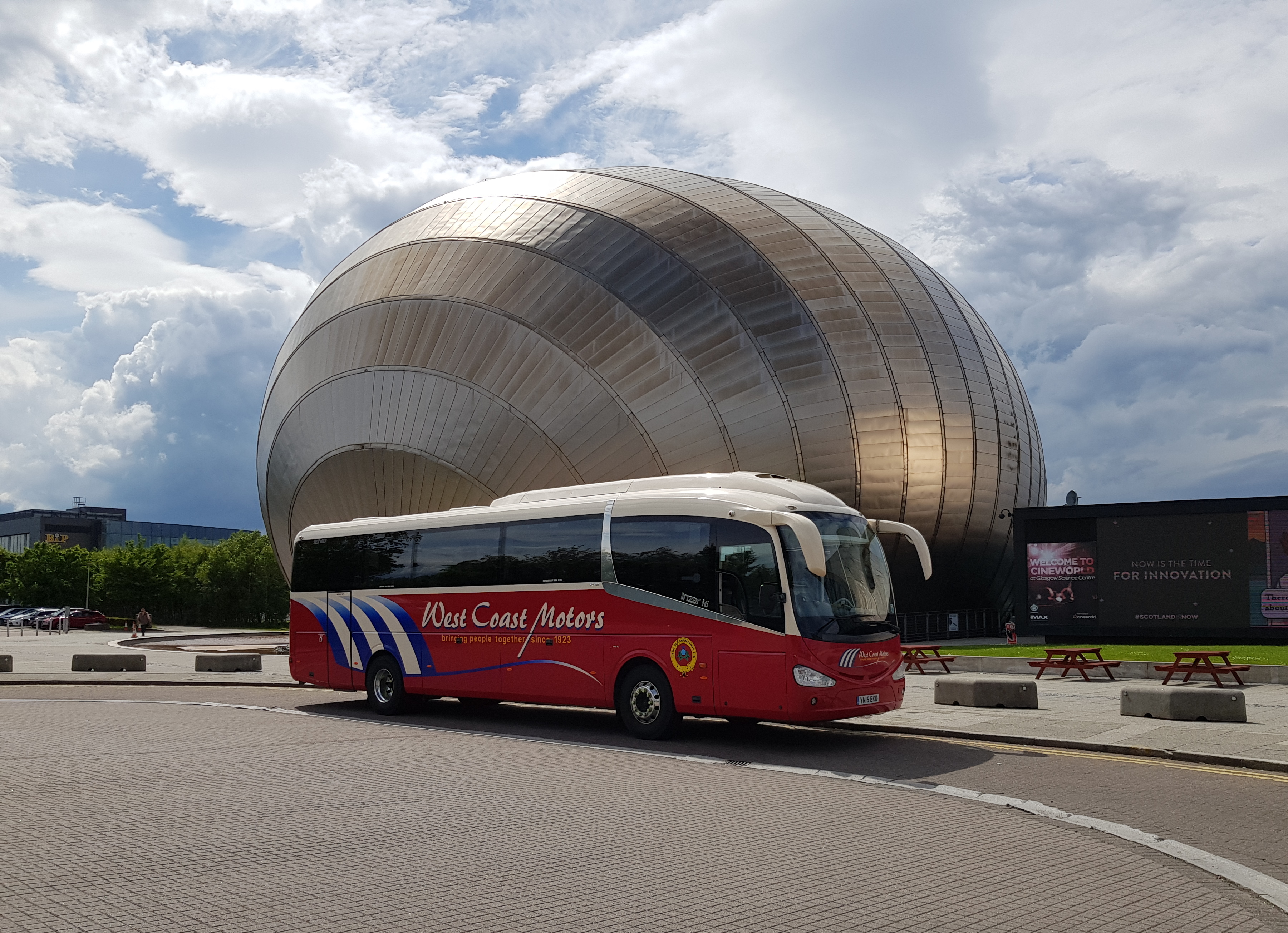 red coach outside glasgow science centre