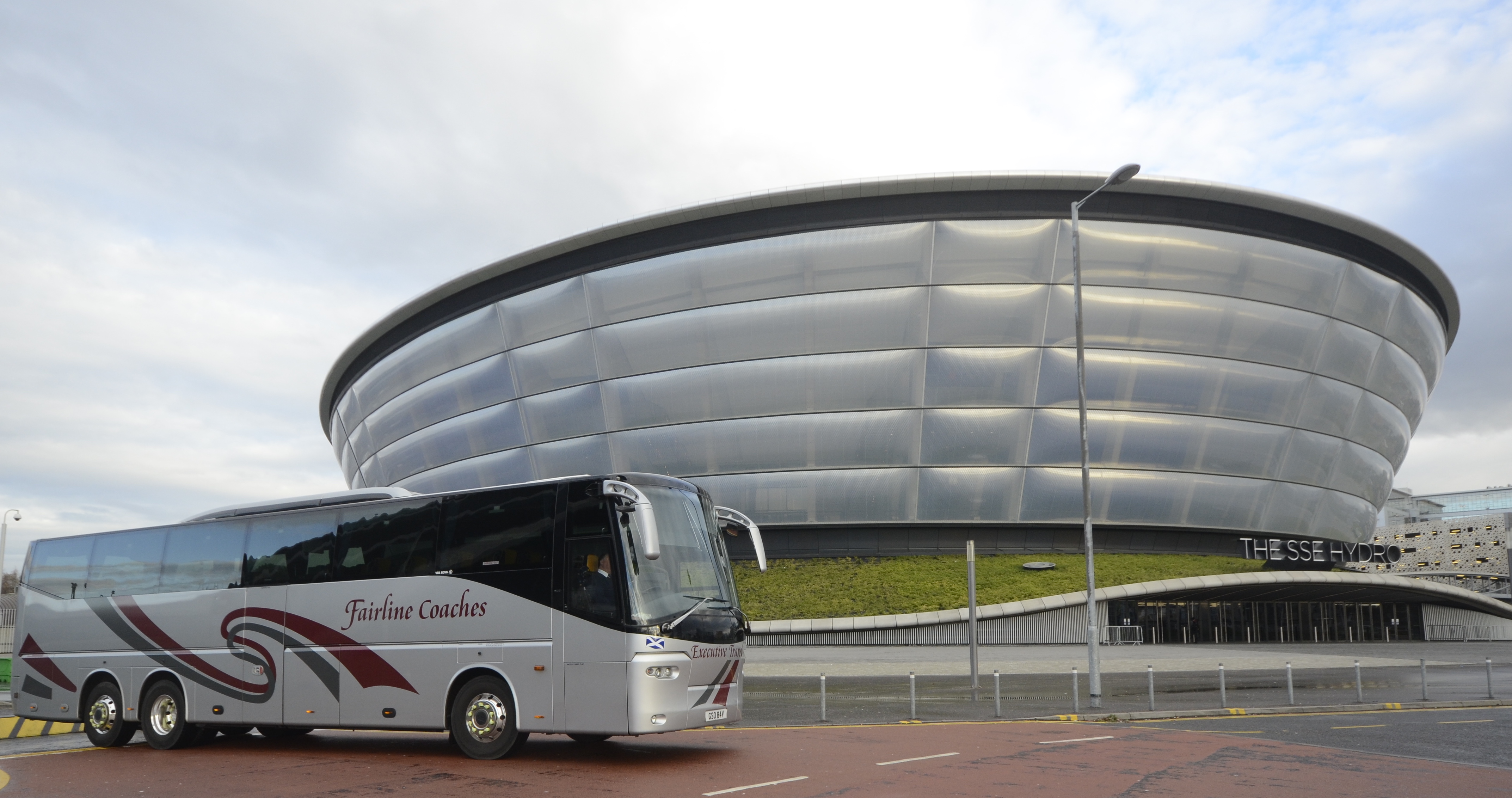 silver coach in front of Hydro
