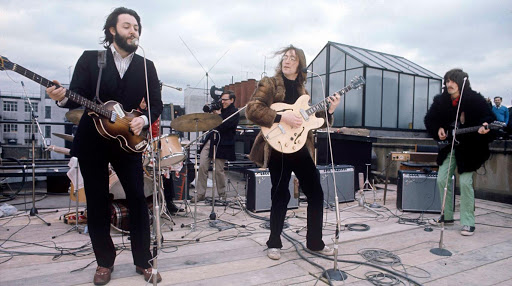 **The Beatles** performing on top of the Apple Corps building in London on 30 January 1969.