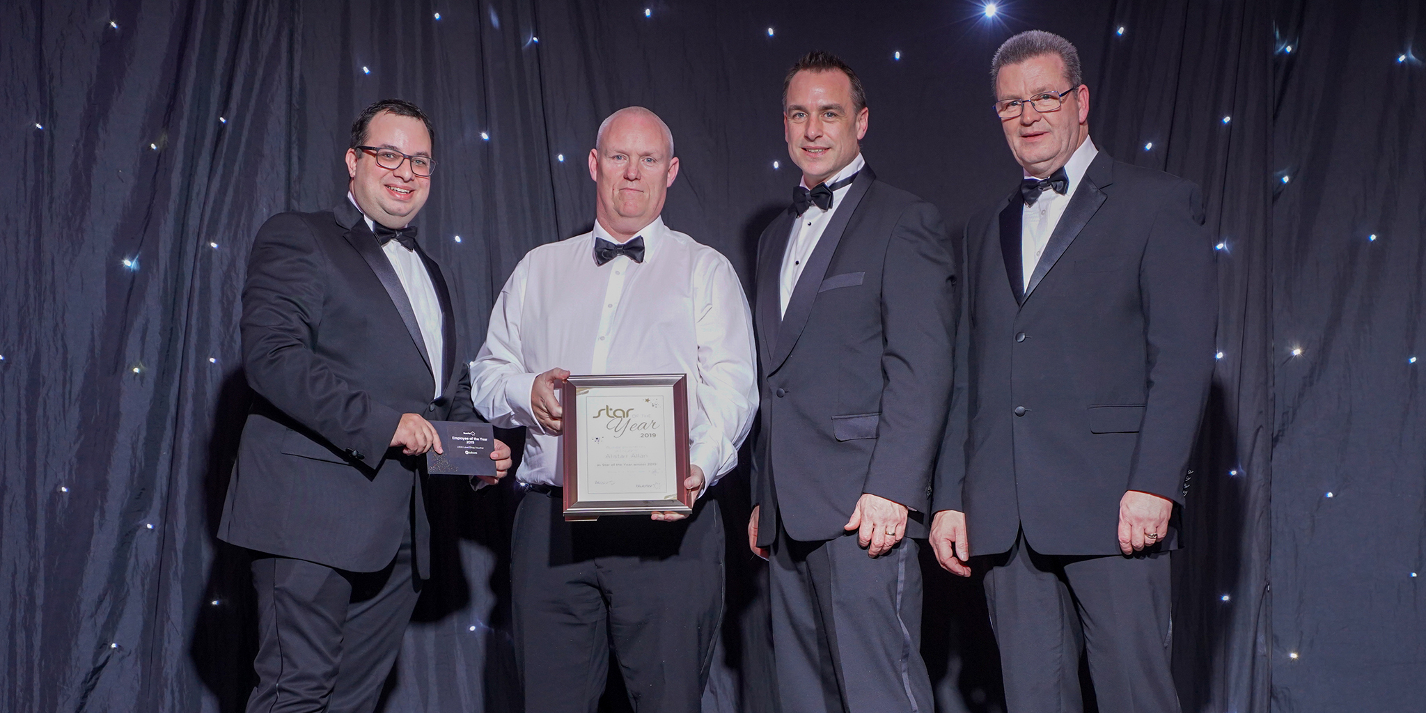 Photo of Bluestar employee of the year Alistair Allan and Bluestar directors, David Lee-Kong, Ben Murray and Steve Hamilton