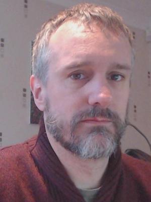 Non-professional recent headshot, facial hair