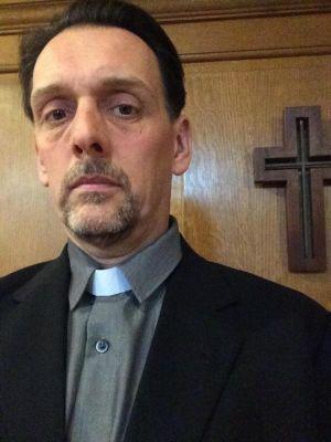 Sam Halpenny as Father Nathaniel in Sugar.