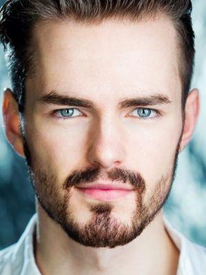 2016 Beard headshot · By: Adam Hills