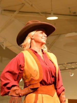 Modeling in Western Design Expo fashion show · By: Sharon Guli, Guli Productions
