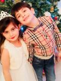 2018 Emelie and Brother Aidin, Christmas · By: Sarah Sohrabi