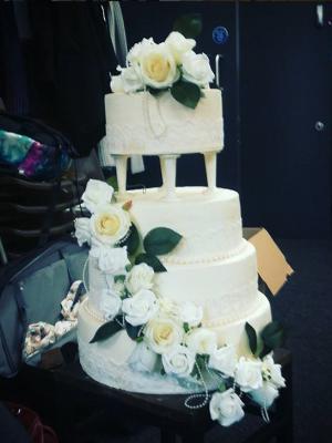Wedding Cake - styrofoam, caulk, fake flowers · By: Sophie Duffin