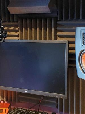 Recording booth in home studio showing Sony Studio Monitor Headphones.
