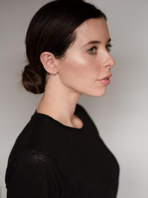 Headshot profile with hair up