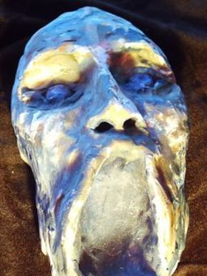 Screaming head sculpture · By: Tracey Booth
