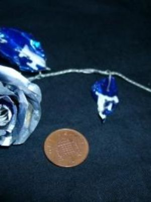 Rose made from aluminium can · By: Tracey Booth