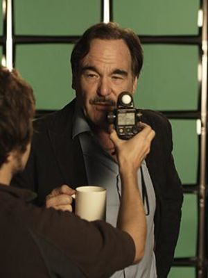 "2011 Phil talking to director Oliver Stone during the commercial for ""Vzaar"" · By: Elisabeth Schusser"