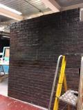 Fake brick wall · By: Alice Loizel
