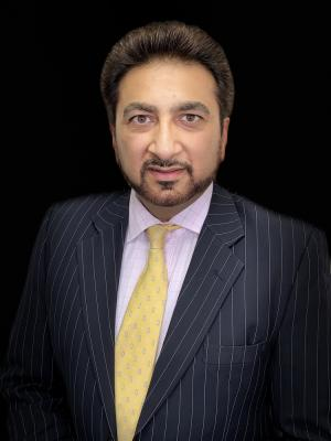 Tahir Ashraf Barrister Voice Over Artist Singer Actor - stubble beard - mid speech side view - right - no glasses