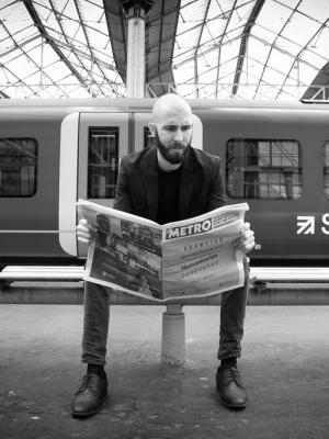 reading the news before missing train
