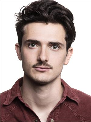 2018 Headshot- Moustache · By: Claire Newman-Williams