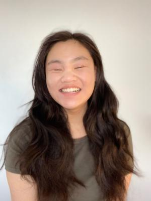 Georgia Tan (smiling with teeth)