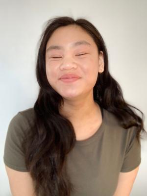 Georgia Tan (smiling without eyes)