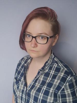 Half body shot, with glasses