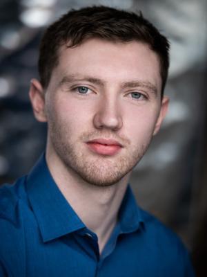 2020 Rhys Clarke_Headshot_Blue · By: Pete Bartlett