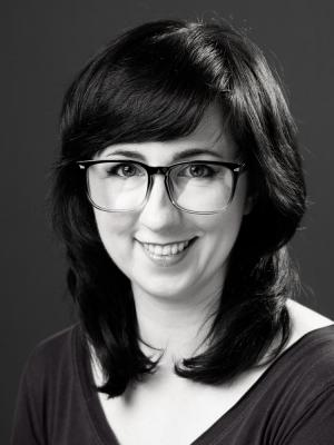 Jessica Winterton smiling with glasses black and white