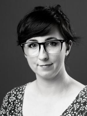 Jessica Winterton with hair up and glasses black and white