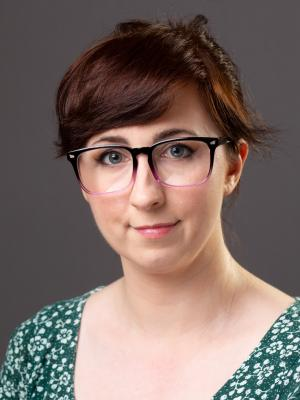 Jessica Winterton with hair up and glasses