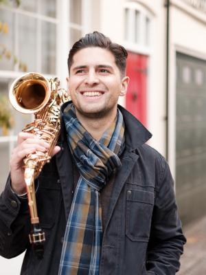 Jon Shenoy outdoor alto sax smiles