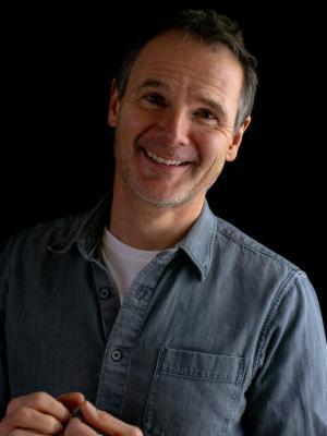 Smiling grey shirt
