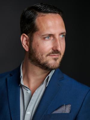 2021 Semi-profile: blue jacket, grey shirt · By: David Myers