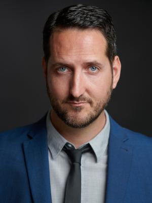 2021 Portrait: blue jacket, grey shirt, black tie. · By: David Myers