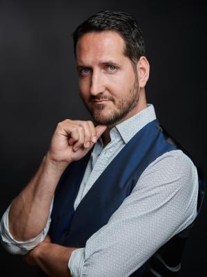 2021 Semi-profile: blue waistcoat, white shirt. · By: David Myers