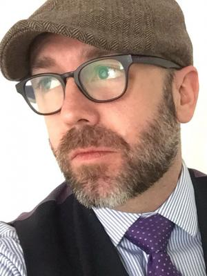 2019 Flat cap, vest and tie shot · By: Brad Pearson