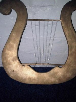 Lyre prop · By: Jennifer Morgan