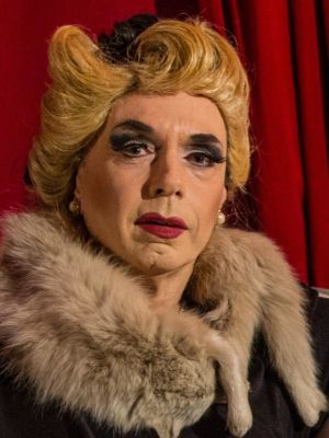 2014 As Castruccio, a drag queen from 'Cover her face' · By: Benjamin Starkin
