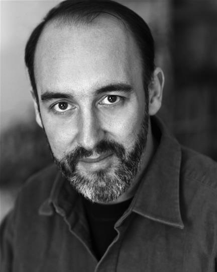Black and white headshot with beard