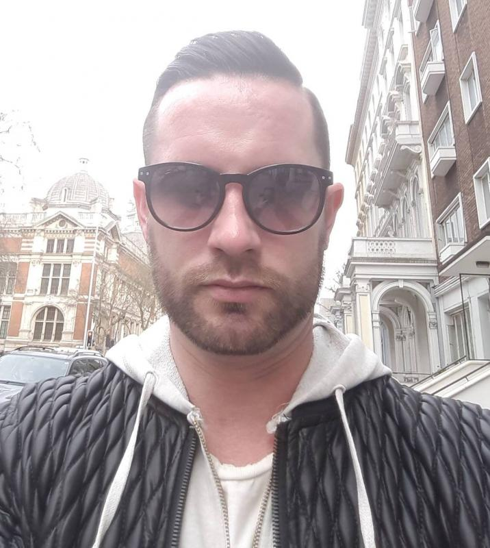 Head shot with short designer beard