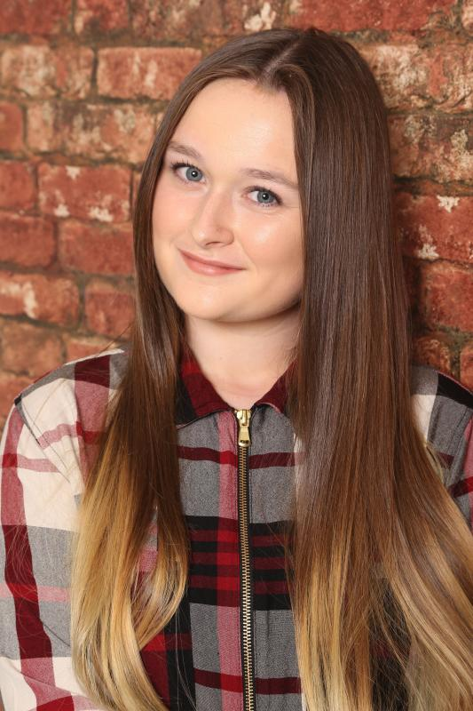 Headshot with checkered shirt, hair down and minimal makeup
