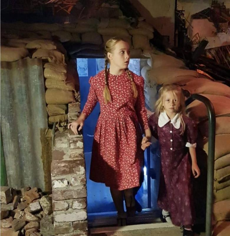 """Playing character """"Young girl"""" (on right) emerging from air raid shelter in film """"Peace in our Time"""""""