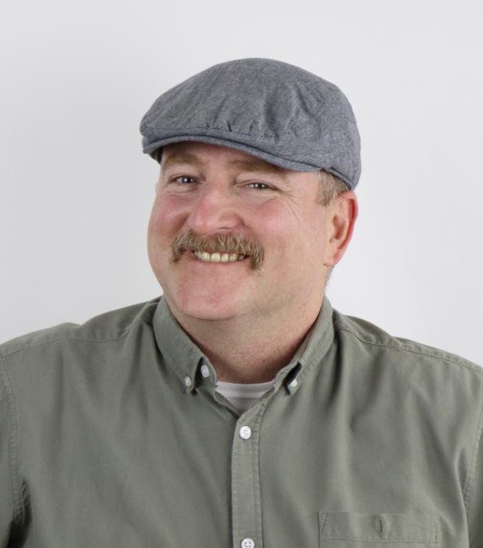 Ruben Carol with moustache and cap