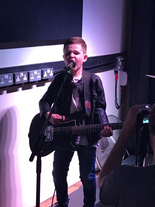 Performing as Guitarist in music video