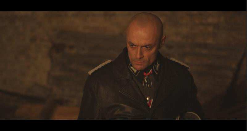 Sean Cronin as SS-MAJOR GENERAL JOSEF HEIDENBERG in ESCAPE TO GOSSAU