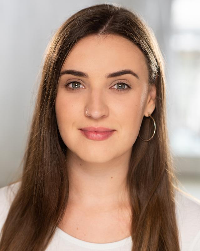 White Top Headshot, Katie Jeromson 2019