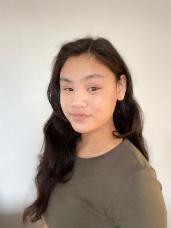 Georgia Tan (cynical smile)