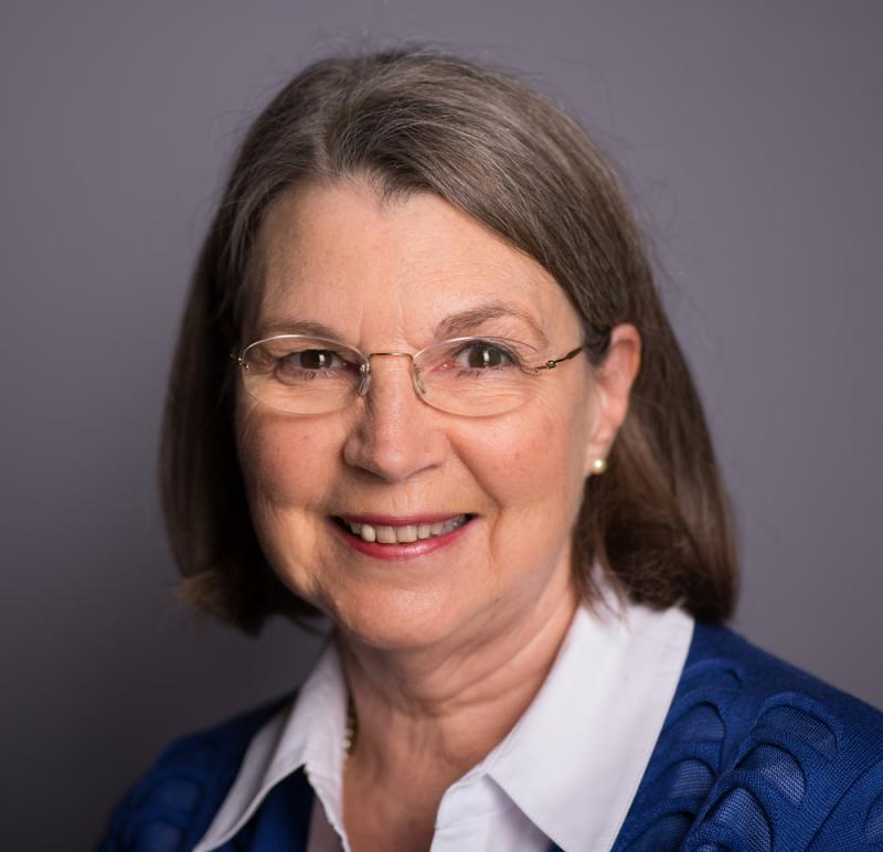 Angela White - open smile headshot
