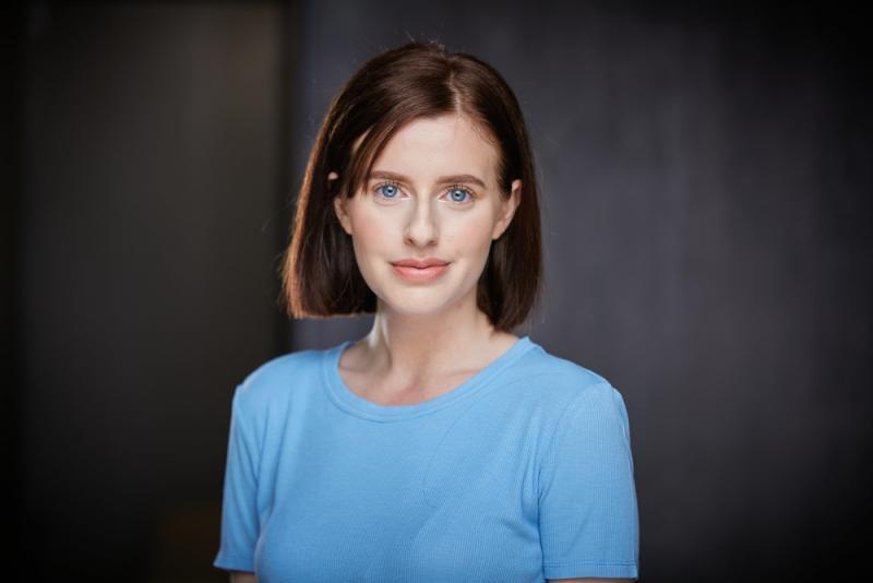 short hair, blue shirt