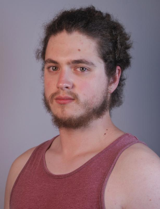 Recent headshot with hair tied back