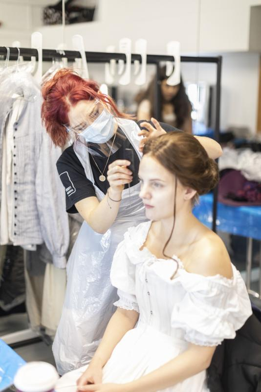Applying a wig for theatre production 'Of Warp and Woof'.